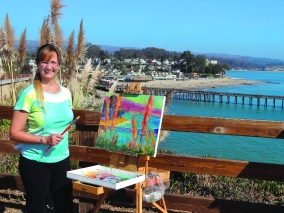 Santa Cruz artist Maggie Renner Hellman frequently paints en plein air in Capitola. Maggie is painting in the competition, and her work also graces the 2015 event poster. Photo by Ron Holman.